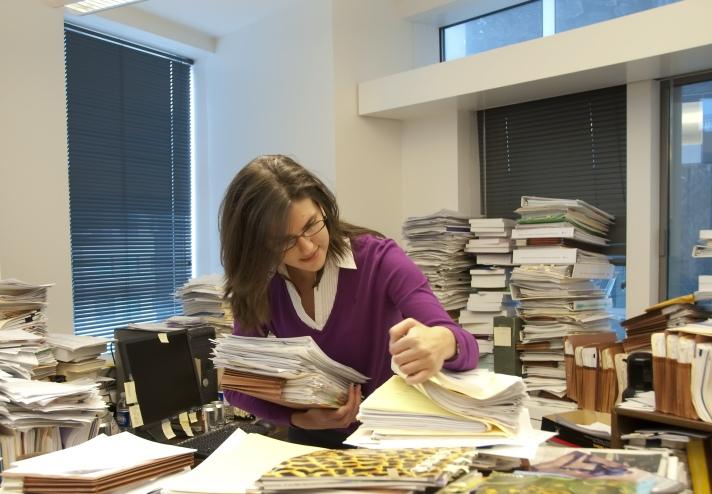 woman-at-cluttered-desk_shutterstock_45044083